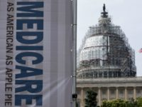 In this July 30, 2015 file photo, a sign supporting Medicare is seen on Capitol Hill in Washington.