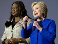 FILE - In this Feb. 23, 2016 file photo, Democratic presidential candidate Hillary Clinton, right, speaks next to Sybrina Fulton, mother of Trayvon Martin, in Columbia, S.C. Sitting in the airy chapel at Mount Ararat Church in Brooklyn, the crowd heard from five women who had lost their children to …