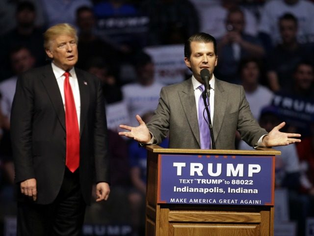 Donald Trump, Jr. speaks as Republican presidential candidate Donald Trump listens during a campaign stop Wednesday, April 27, 2016, in Indianapolis. (AP Photo/Darron Cummings)