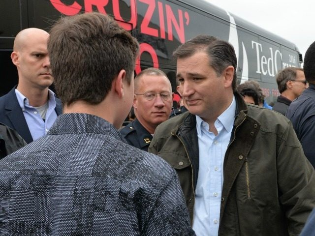 Republican presidential candidate Sen. Ted Cruz, R-Texas, talks with a supporter during a stop of his presidential campaign Thursday April 28, 2016 at an Elkhart, Ind. restaurant. (AP Photo/Joe Raymond)
