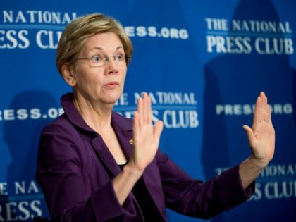 FILE - In this Nov. 18, 2015, file photo, Sen. Elizabeth Warren, D-Mass. gestures before speaking at the National Press Club in Washington.