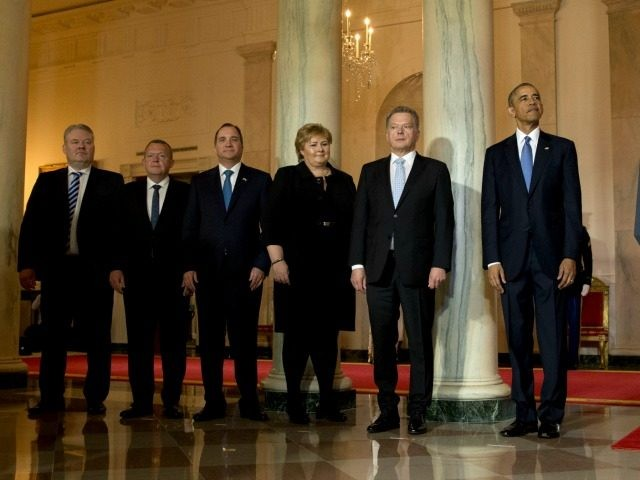 President Barack Obama stands with, from left, Iceland Prime Minister Sigurdur Ingi Johannsson, Danish Prime Minister Lars Lokke Rasmussen, Swedish Prime Minister Stefan Lofven, Norwegian Prime Minister Erna Solberg, Finnish President Sauli Niinisto, and President Barack Obama during an arrival ceremony in the Grand Foyer of the White House in …