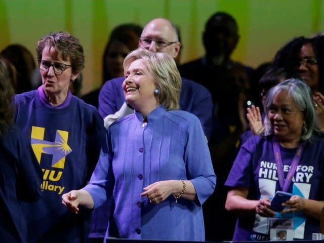 Democratic presidential candidate Hillary Clinton meets with Service Employees International Union members at the union's 2016 International Convention, Monday, May 23, 2016 in Detroit. At left is union president Mary Kay Henry. (AP Photo/Carlos Osorio)