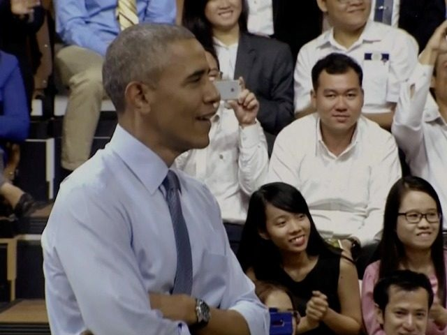 In this image made from pool video, U.S. President Barack Obama listens as Vietnamese rapper Suboi raps during a town-hall style event for the Young Southeast Asian Leadership Initiative (YSEALI) at the GEM Center in Ho Chi Minh City, Vietnam, Wednesday, May 25, 2016.