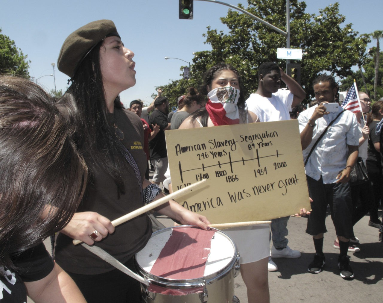 Several hundred people protest outside a campaign rally for Republican presidential candidate Donald Trump in Fresno, Calif., on Friday, May 27, 2016. The largely young and Latino crowd beat drums, chanted anti-Trump slogans and marched around the arena in downtown Fresno. Protesters were met by police officers wearing riot gear, who arrested two people after the rally on suspicion of unlawful assembly. (AP Photo/Scott Smith)