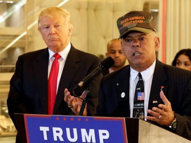 Republican presidential candidate Donald Trump listens at ;eft as Al Baldasaro, a New Hampshire state representative, speaks during a news conference in New York, Tuesday, May 31, 2016.