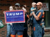 Coal miner Chris Steele holds a sign supporting Donald Trump outside a Democratic presidential candidate Hillary Clinton event in Williamson, W.V., Monday, May 2, 2016.