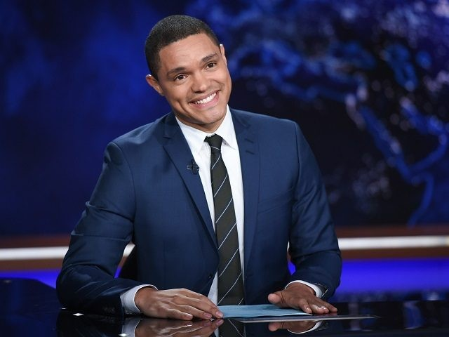 """FILE - In this Sept. 29, 2015 file photo, Trevor Noah appears during a taping of """"The Daily Show with Trevor Noah"""" in New York. Noah replaced host Jon Stewart, who left the show in July. (Photo by Evan Agostini/Invision/AP, File)"""