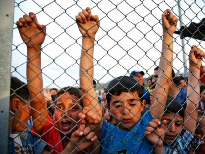Syrian refugee children behind a fence at the Nizip refugee camp in Gaziantep province, southeastern Turkey Saturday, April 23, 2016.
