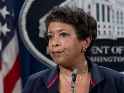 Attorney General Loretta Lynch pauses as she speaks during a news conference at the Justice Department in Washington, Wednesday, Feb. 10, 2016, about Ferguson, Missouri. The federal government sued Ferguson on Wednesday, one day after the city council voted to revise an agreement aimed at improving the way police and …