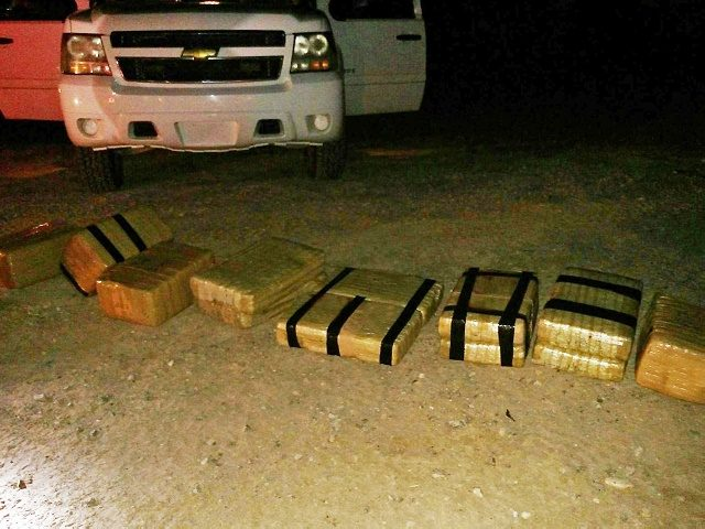 This undated photo provided by the U.S. Customs and Border Protection shows some 180 pounds of marijuana that was brought into the U.S. from Mexico aboard a go-cart, seen near Yuma, Ariz. The go-cart crossed into the United States and fled back to Mexico after unloading $90,000 worth of drugs. …