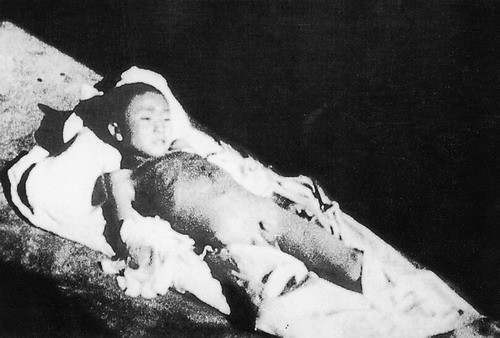 A seven-year-old child bayoneted to death by Japanese. (Wikimedia Commons)