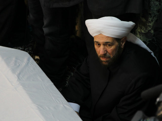 Syria's Grand Mufti Ahmed Badr al-Din al-Hassoun sits near the coffins of a senior pro-Syrian government Muslim cleric Mohammed al-Buti and his grandson Ahmad al-Buti, killed in a mosque explosion on Thursday, during funeral prayers at Umayyad Mosque, in Damascus March 23,... REUTERS/KHALED AL-HARIRI