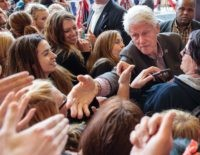 Bill Clinton handshake women (Rob Kerr / AFP / Getty)