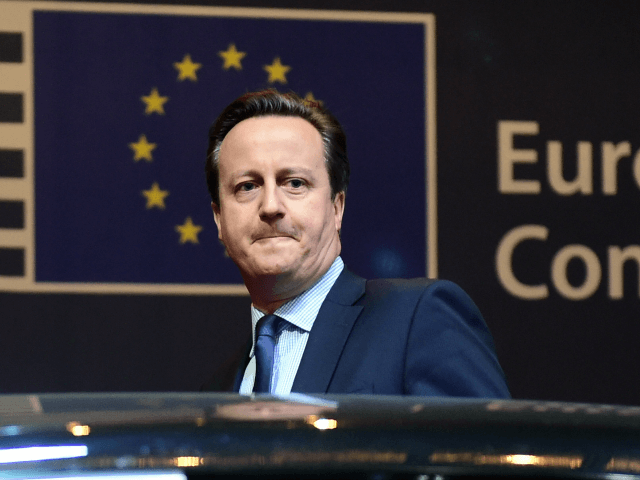 British Prime Minister David Cameron leaves at the end of the first day of an European Council leaders' meeting in Brussels, February 19, 2016.