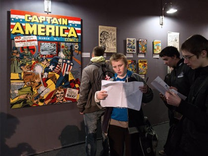 A copy of the March 1941 first cover of US comic 'Captain America' by US artist Jack Kirby is displayed (L) as youths attend the 42nd Angouleme International Comics Festival (Festival international de la bande dessinee d'Angouleme) on Friday 30, 2015 in Angouleme, central France.