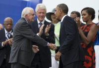 President Barack Obama shakes hands with former President Jimmy Carter, left, during a ceremony commemorating the 50th anniversary of the March on Washington, Wednesday, Aug. 28,2013, at the Lincoln Memorial in Washington. The president was set to lead civil rights pioneers Wednesday in a ceremony for the 50th anniversary of …