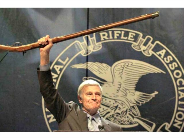 Charleston Heston brandishes rifle NRA AP