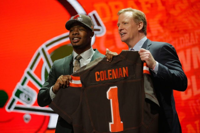 CHICAGO, IL - APRIL 28: (L-R) Corey Coleman of Baylor holds up a jersey with NFL Commissioner Roger Goodell after being picked #15 overall by the Cleveland Browns during the first round of the 2016 NFL Draft at the Auditorium Theatre of Roosevelt University on April 28, 2016 in Chicago, …