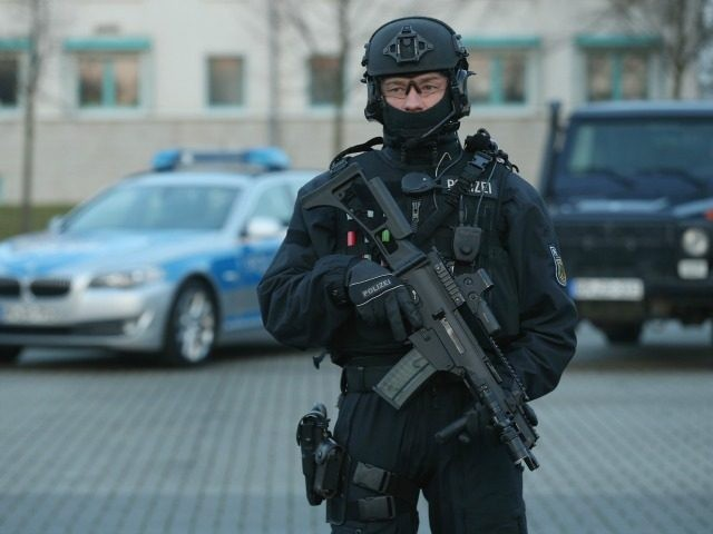 A member of the new BFEplus anti-terror unit of the German federal police holds a G36C automatic weapon after taking part in a capabilities demonstration at a police training facility on December 16, 2015 in Ahrensfelde, Germany.