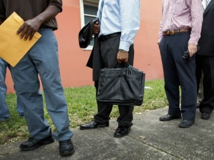 Job seekers line up to apply for an opening on November 15, 2011 in Miami, Florida.