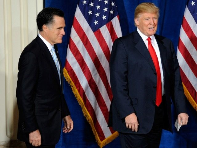 Mitt Romney (L) and Donald Trump arrive at a news conference held by Trump to endorse Romney for president February 2, 2012 in Las Vegas, Nevada.