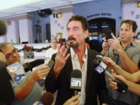 "MIAMI BEACH, FL - DECEMBER 13: John McAfee talks to the media outside Beacon Hotel where he is staying after arriving last night from Guatemala on December 13, 2012 in Miami Beach, Florida. McAfee is a ""person of interest"" in the fatal shooting of his neighbor in Belize and turned …"