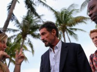 "MIAMI BEACH, FL - DECEMBER 13: John McAfee interacts with people after speaking to reporters outside of the Beacon Hotel where he is staying after arriving last night from Guatemala on December 13, 2012 in Miami Beach, Florida. McAfee is a ""person of interest"" in the fatal shooting of his …"