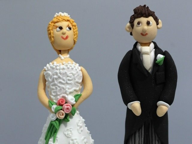 figurines and displayed on a cake during the National Wedding Show at London's Olympia on February 22, 2013 in London, England.