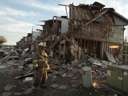 WEST, TX - APRIL 18: A Valley Mills Fire Department personnel walks among the remains of an apartment complex next to the fertilizer plant that exploded yesterday afternoon on April 18, 2013 in West, Texas. According to West Mayor Tommy Muska, around 14 people, including 10 first responders, were killed …