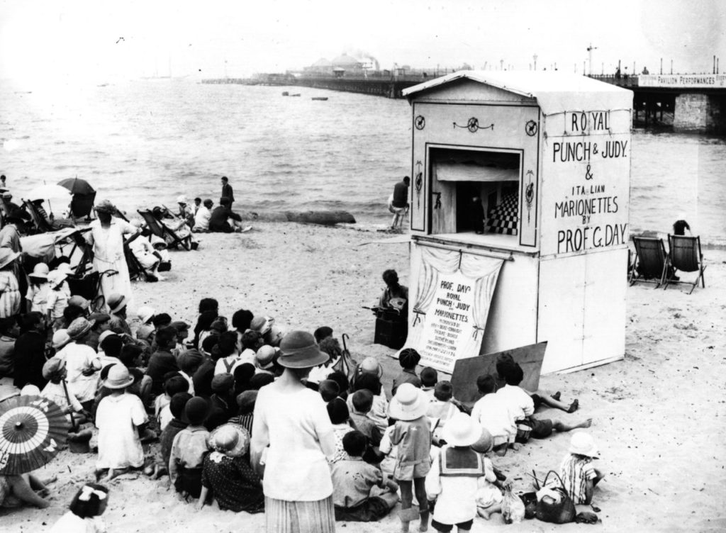 16th July 1926: Crowds watching a Punch and Judy show on the beach at Ryde, on the Isle of Wight. (Photo by Central Press/Getty Images)