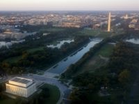 Washington, DC, including the Lincoln Memorial, Washington Monument, US Capitol and National Mall, is seen from the air at sunset in this photograph taken on June 15, 2014. AFP PHOTO / Saul LOEB (Photo credit should read