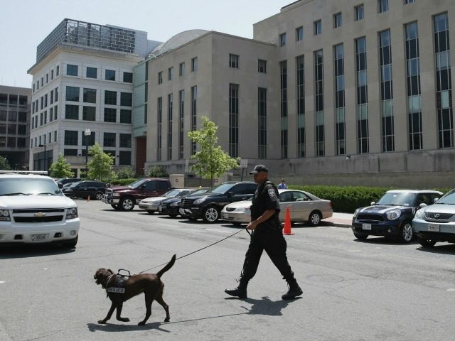 : A Federal Facilities Protection Service K9 and handler inspect the vehicles parked outside Prettyman Federal Court House where Ahmed Abu Khattala, one of the suspected ringleaders of the 2012 attacks in Benghazi, Libya, had a pretrial detention hearing July 2, 2014 in Washington, DC. Abu Khattala was seized June …