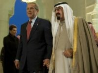 George W. Bush and Saudi Arabia's King Abdullah bin Abdul Al Aziz al-Saud hold hands in Riyadh, Saudi Arabia 14 January 2008.