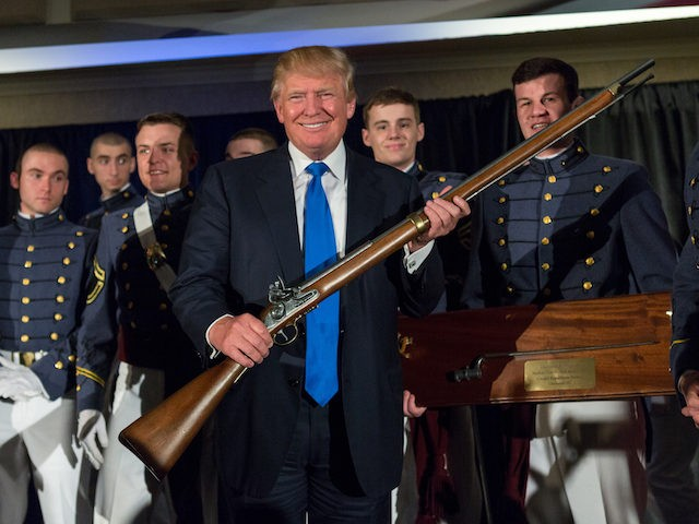 CHARLESTON, SC - FEBRUARY 22: Reality TV host and New York real estate mogul Donald Trump holds up a replica flintlock rifle awarded him by cadets during the Republican Society Patriot Dinner at the Citadel Military College on February 22, 2015 in Charleston, South Carolina. Trump and U.S. Sen. Tim …