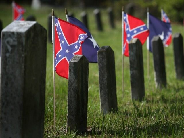 Confederate flags fly over the graves of Confederate soldiers burried in Magnolia Cemetery on July 14, 2015 in Charleston, South Carolina.