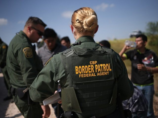 MCALLEN, TX - AUGUST 07: U.S. Border Patrol agents detain undocumented immigrants after they crossed the border from Mexico into the United States on August 7, 2015 in McAllen, Texas. The state's Rio Grande Valley corridor is the busiest illegal border crossing into the United States. Border security and immigration …