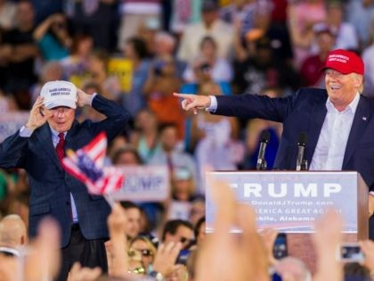 U.S. Republican presidential candidate Donald Trump introduces Alabama Senator Jeff Sessions (R) Mobile during his rally at Ladd-Peebles Stadium on August 21, 2015 in Mobile, Alabama.