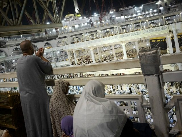 Muslim pilgrims pray near the Islam's holiest shrine, the Kaaba, at the Grand Mosque in Saudi Arabia's holy Muslim city of Mecca late on September 26, 2015.