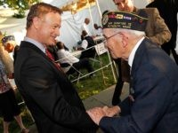 WASHINGTON, DC - MAY 25: Gary Sinise (L) talks with a WWII veteran backstage at the 25th National Memorial Day Concert at the U.S. Capitol, West Lawn on May 25, 2014 in Washington, DC. (Photo by Paul Morigi/Getty Images for Capitol Concerts)