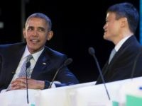 Barack Obama speaks with the chairman of e-commerce giant Alibaba, Jack Ma (R), during the Asia-Pacific Economic Cooperation (APEC) CEO summit in Manila on November 18, 2015.