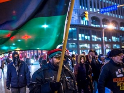 Demonstrators block traffic as they march through the intersection of Prospect and E. 9th St. on December 29, 2015 in Cleveland, Ohio.
