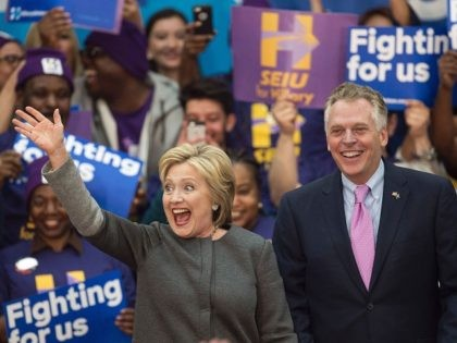 Democratic presidential hopeful Hillary Clinton waves to the crowd beside Virginia Governor Terry McAuliffe during a campaign rally February 29, 2016 at George Mason University in Fairfax, Virginia. / AFP / PAUL J. RICHARDS        (Photo credit should read PAUL J. RICHARDS/AFP/Getty Images)