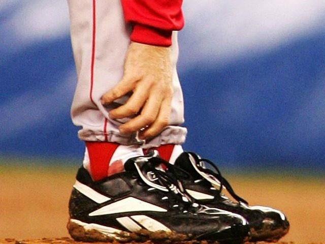 Curt Schilling #38 of the Boston Red Sox grabs at his ankle as it appears to be bleeding in the fourth inning during game six of the American League Championship Series against the New York Yankees on October 19, 2004 at Yankee Stadium in the Bronx borough of New York …