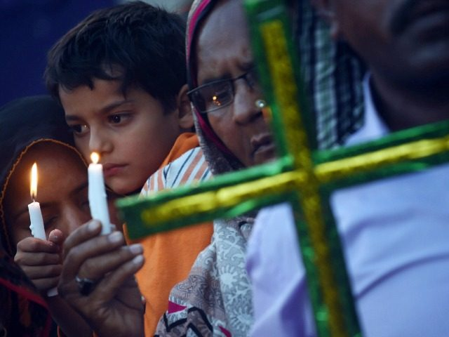 Pakistani Christians hold candles as they stage a rally in Lahore on March 29, 2016