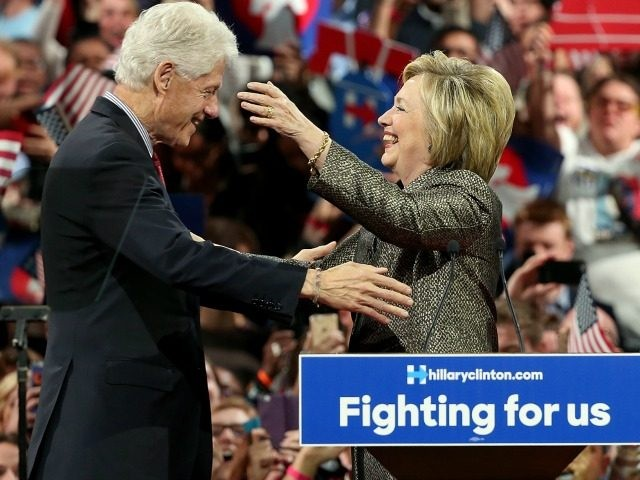 APRIL 26: Democratic presidential candidate and former U.S. Secretary of State Hillary Clinton embraces her husband, former President Bill Clinton, at a primary night campaign event April 26, 2016 in Philadelphia, Pennsylvania.