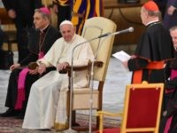 Pope Francis listens to cardinal Cardinal Gianfranco Ravasito during an audience on April 29, 2016.