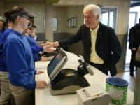 Former President Bill Clinton greets workers on April 30, 2016 in Kokomo, Indiana.