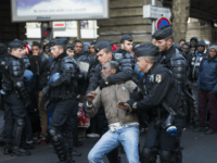 In Pictures: Hundreds Of Migrants Removed From Paris As Police Break Up Camp