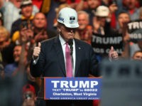 CHARLESTON, WV - MAY 05: Republican Presidential candidate Donald Trump models a hard hat in support of the miners during his rally at the Charleston Civic Center on May 5, 2016 in Charleston, West Virginia. Trump became the Republican presumptive nominee following his landslide win in indiana on Tuesday.(Photo by …